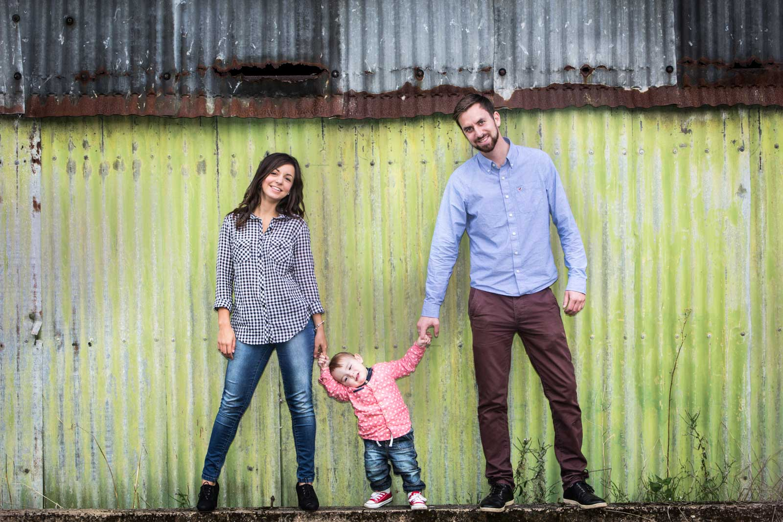 Engagement Photo of family against a grungy corrugated wall