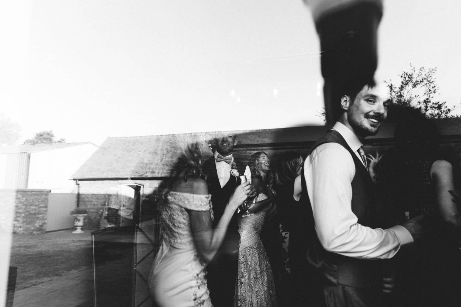 reflection of wedding guest in swallows nest barn