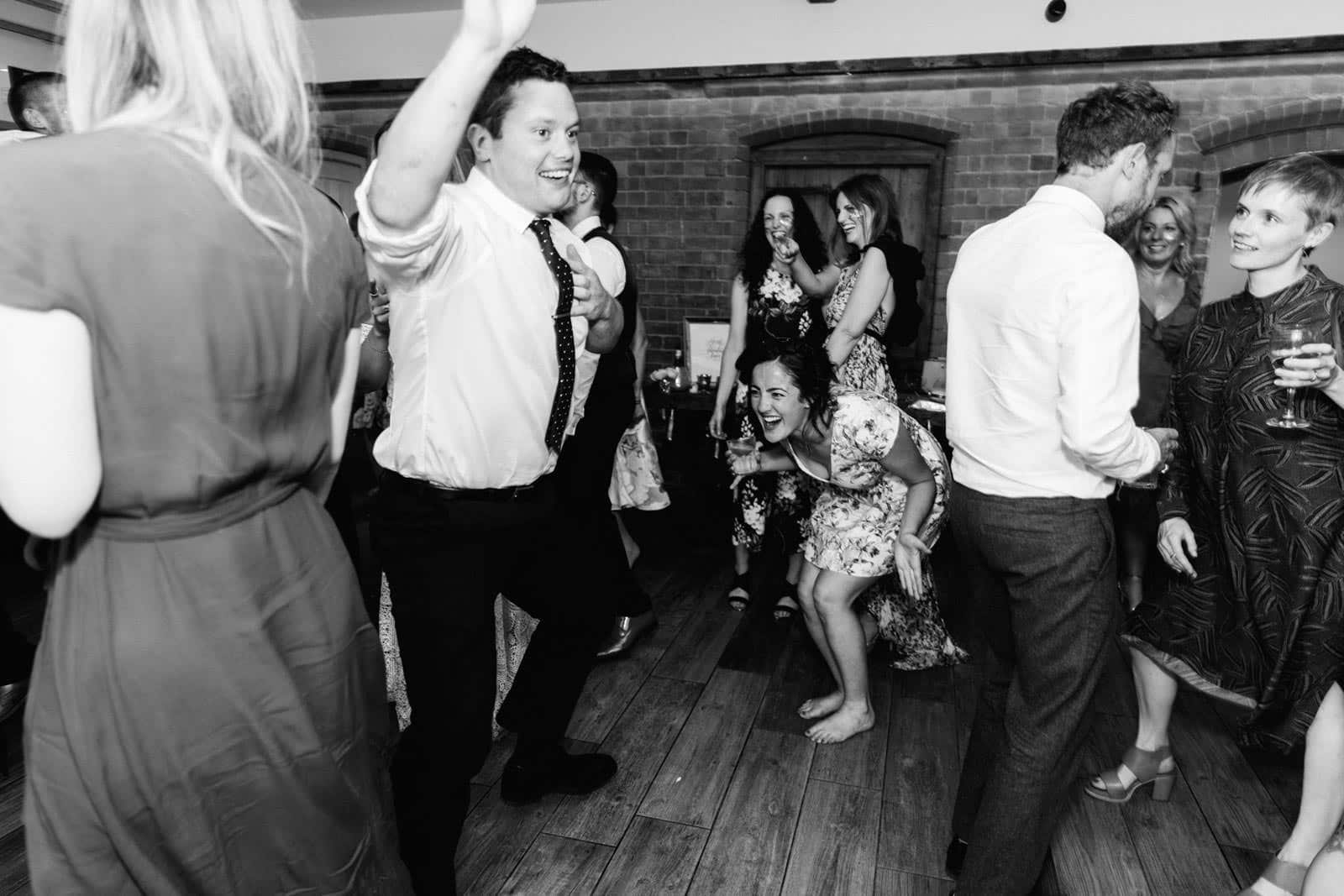 silly dancing antics at a wedding