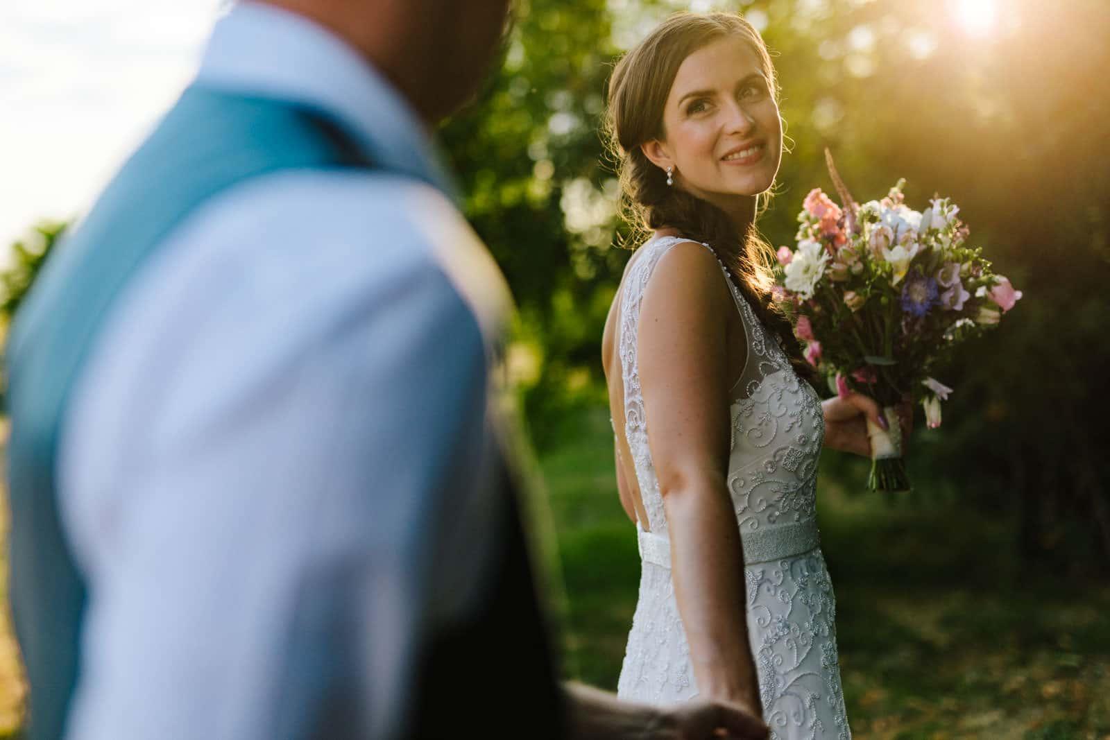 Bride admiringly looking at her groom