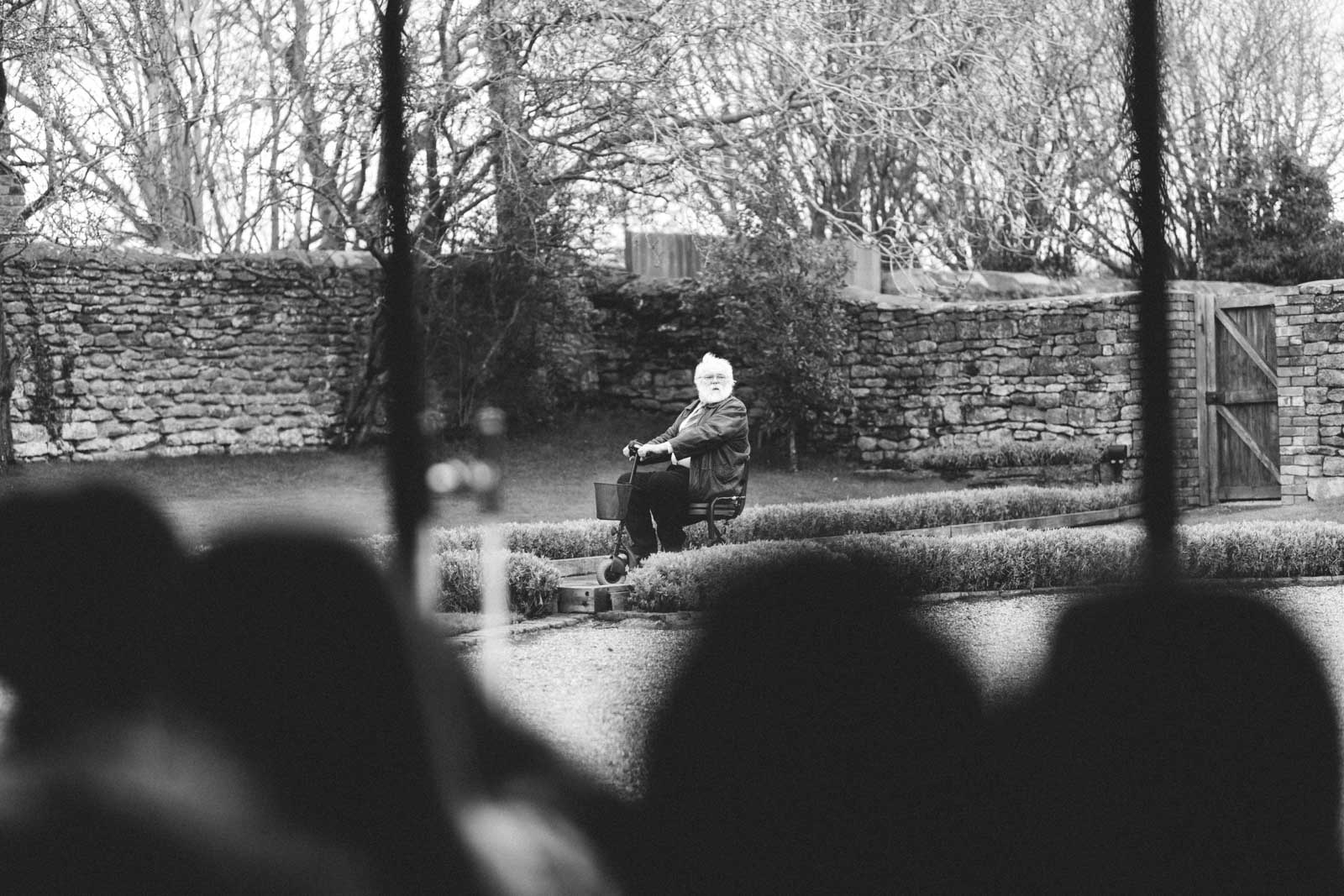 wedding guest making a late entrance on a mobility skooter