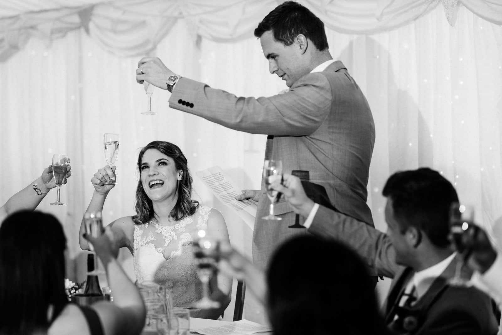 cheers to the bride with all the guests celebrating the beautiful bride