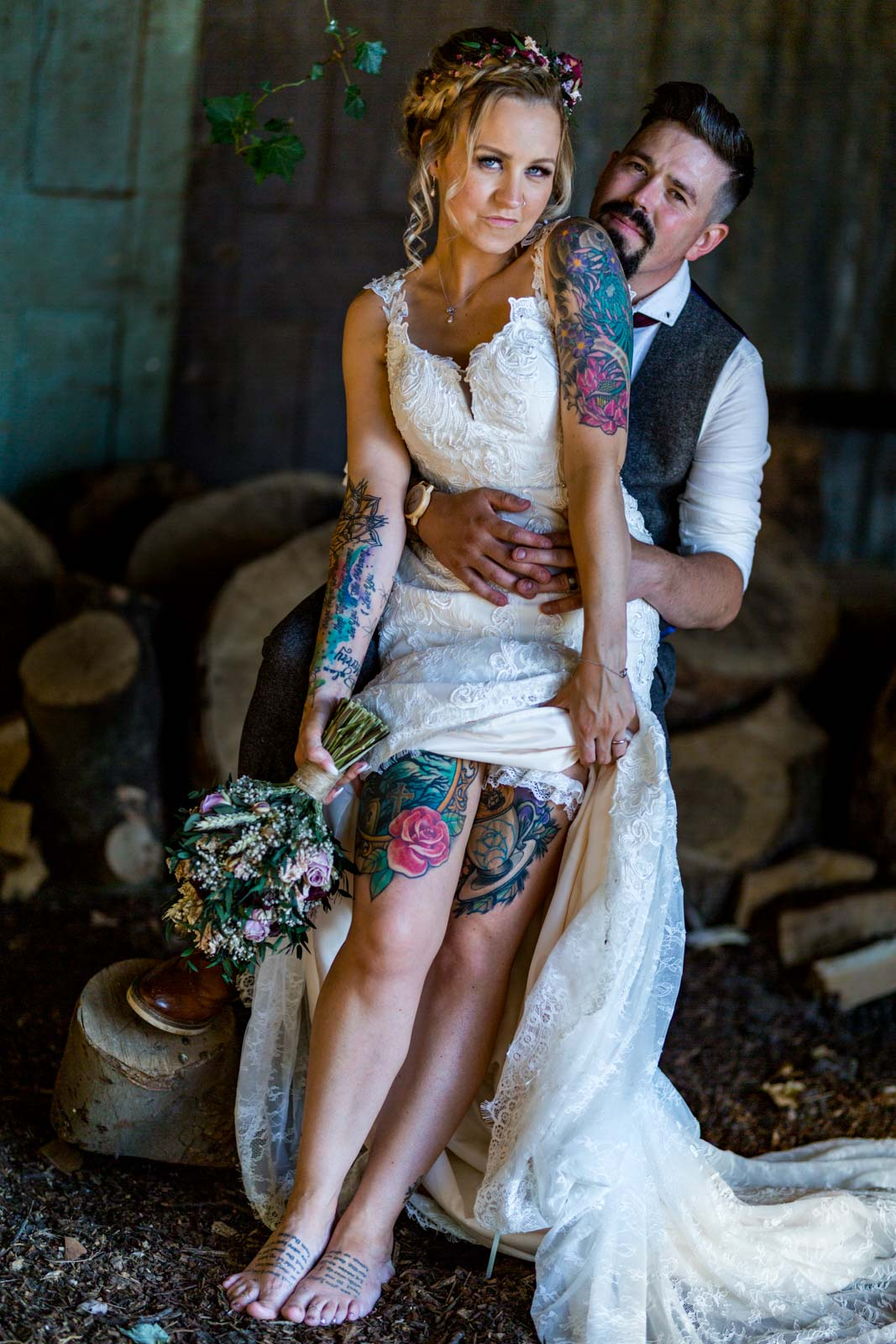 Rock bride showing her tattoos and her ethereal themed wedding