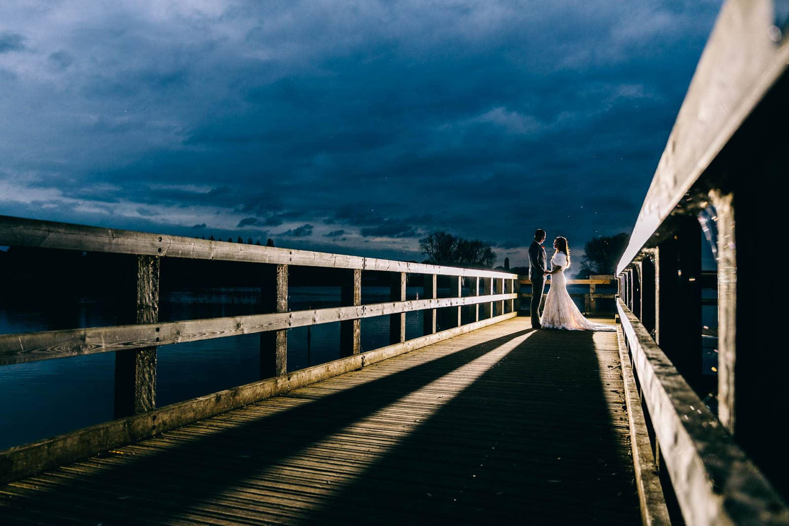 Off camera flash wedding photo at Wicksteed Park on the lake