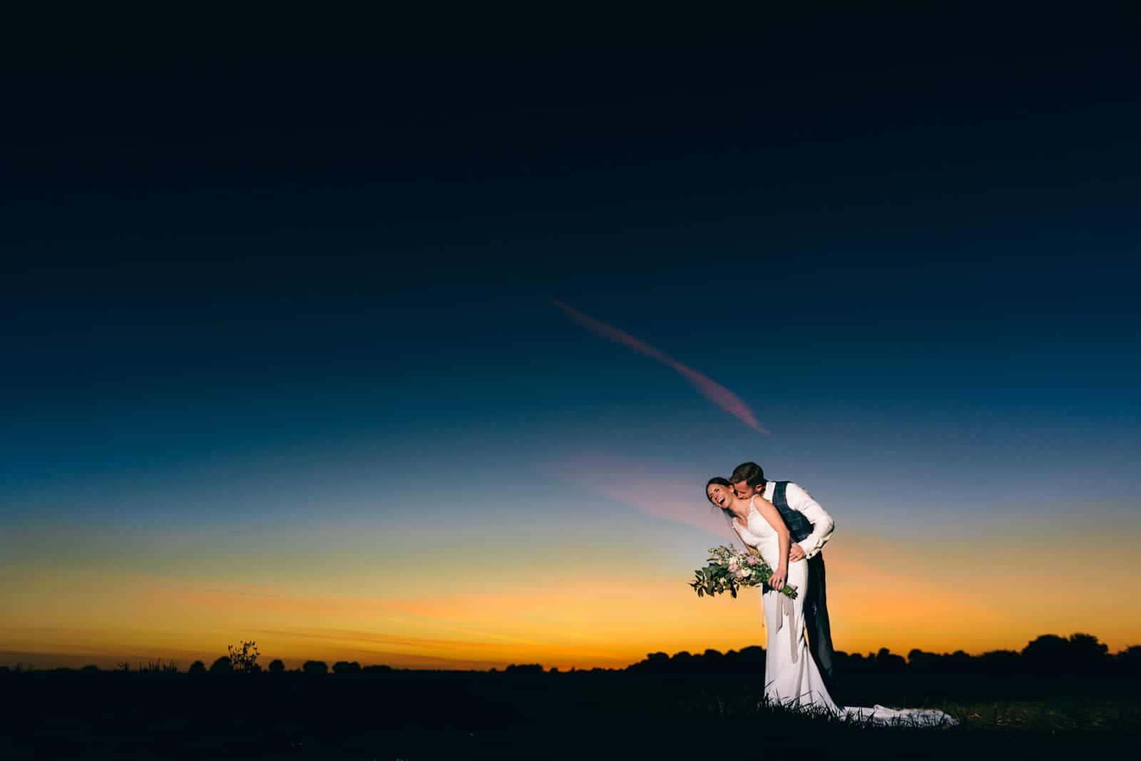 Wedding Photographers in Warwickshire capturing this beautiful wedding and their guests all waving