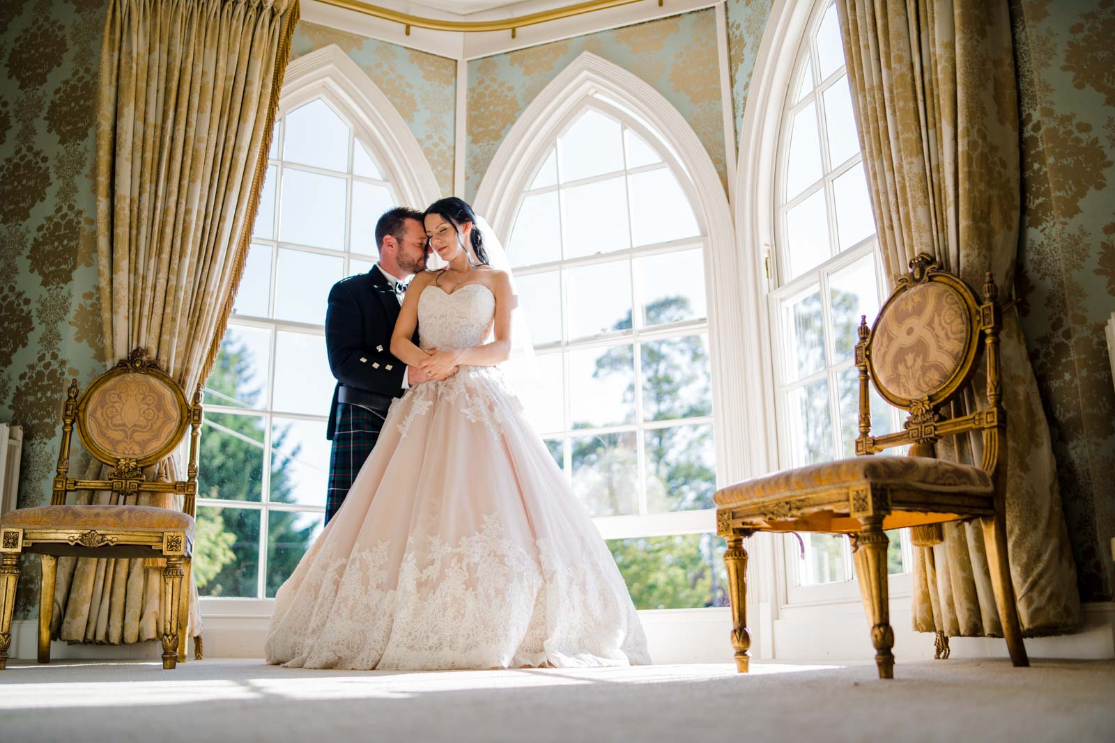 Warwick house wedding photographer, couple embracing in the bridal suite