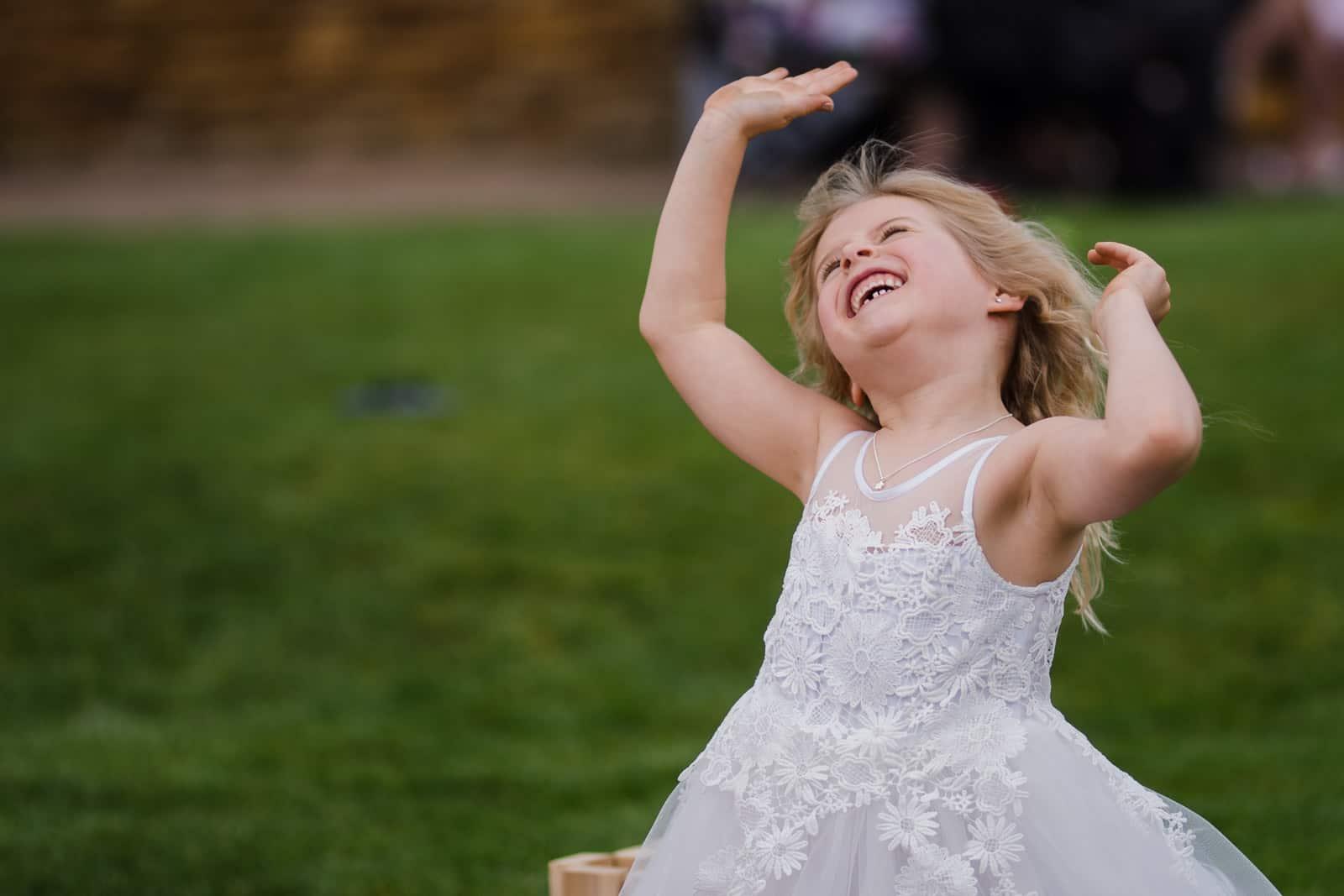Little girl dancing at a wedding