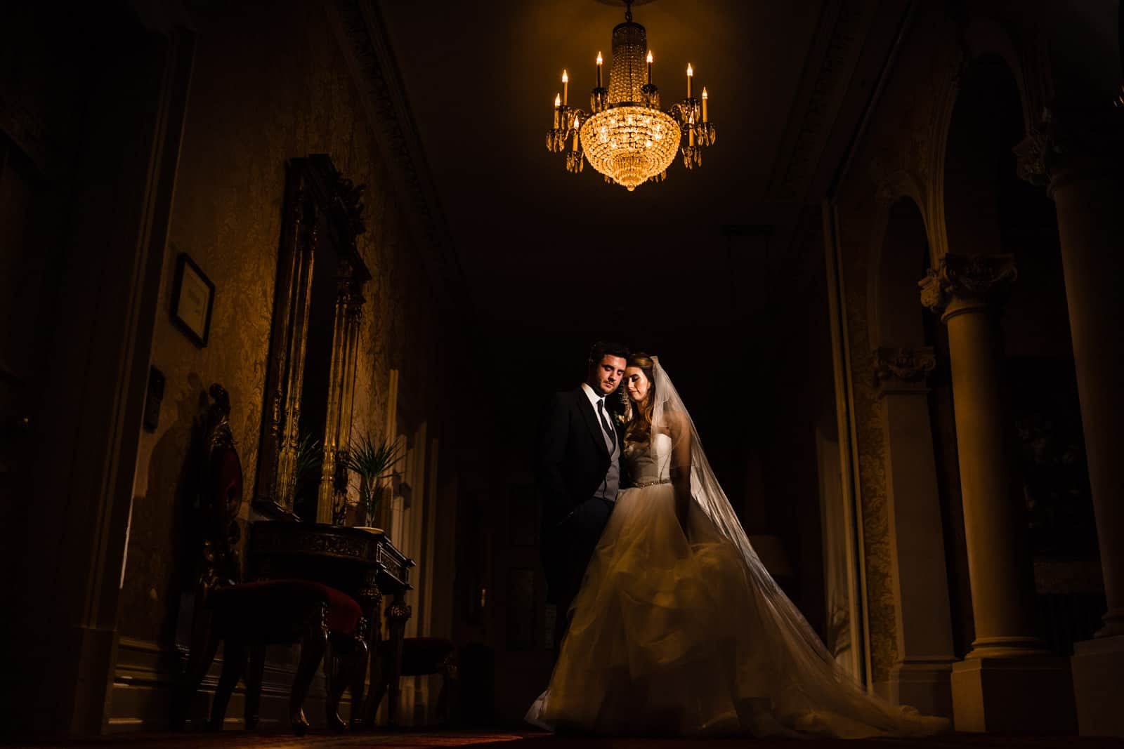 Beautiful wedding photography of a couple standing in the corridors of Kilworth house, creative lighting Wedding Photographer Leicestershire