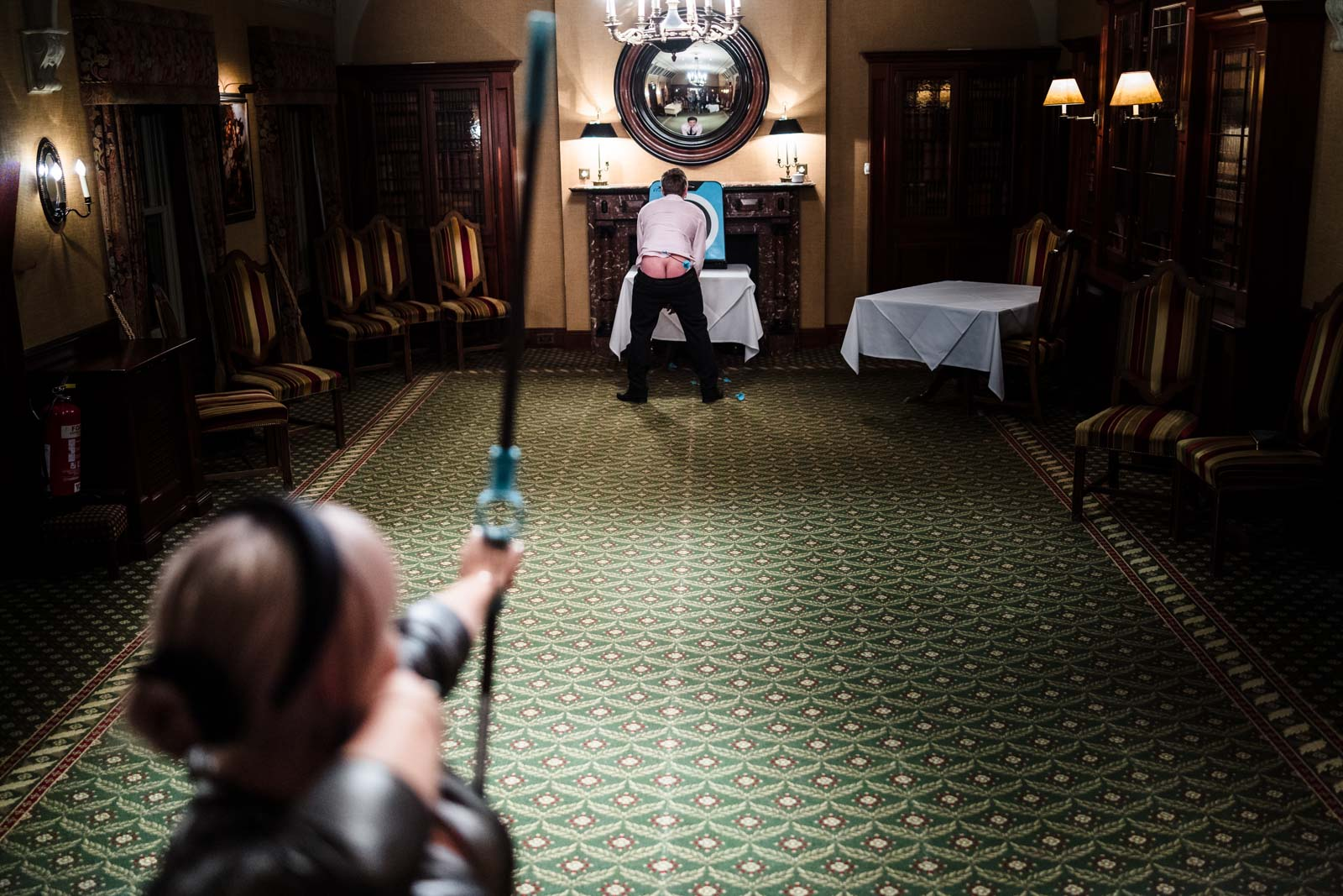 Wedding guests shooting toy arrows at a bare arse Wedding Photographer Leicestershire