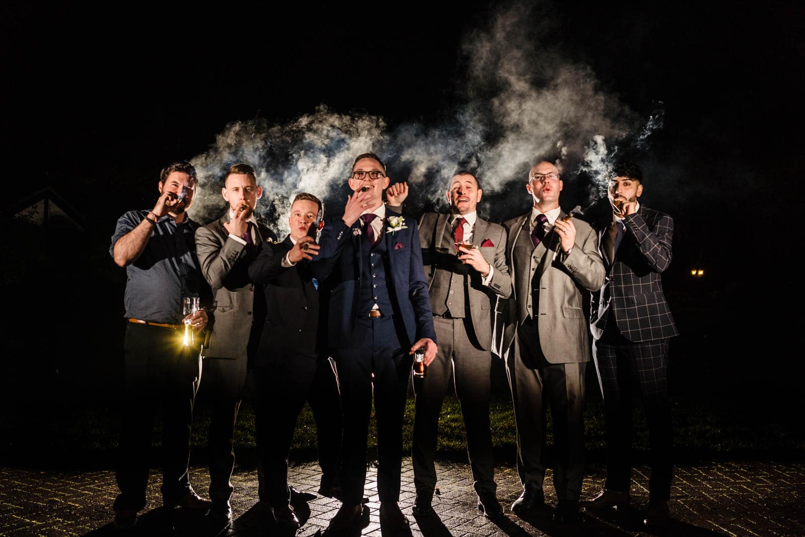 Milton Keynes Wedding Photographers - epic Off camera flash, groomsmen cigar photo using magmod and godox flashes