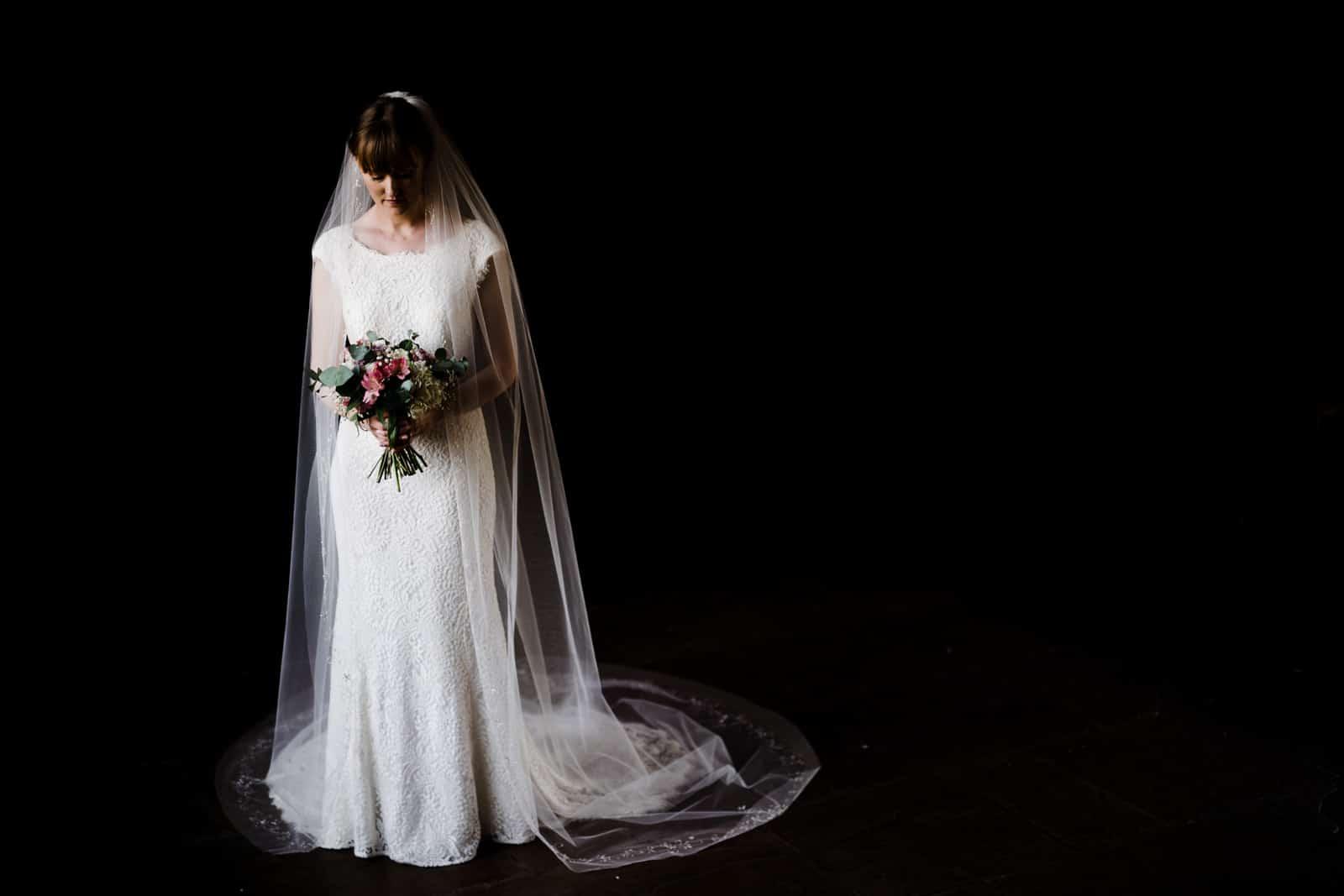 Wedding Photographer Rutland shooting a bride at Dodfod manor