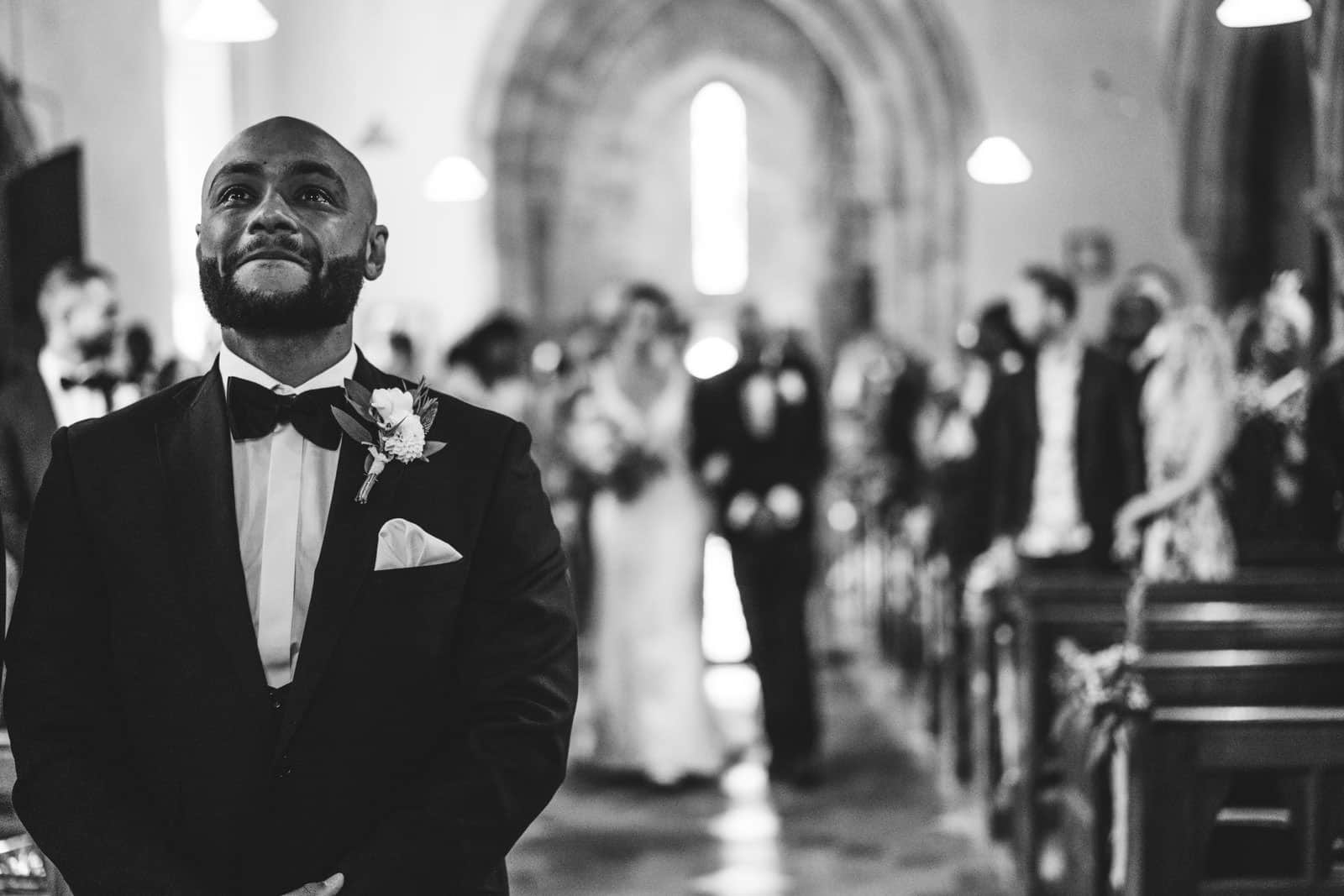 Epic Emotional groom waiting at the altar for his bride to arrive