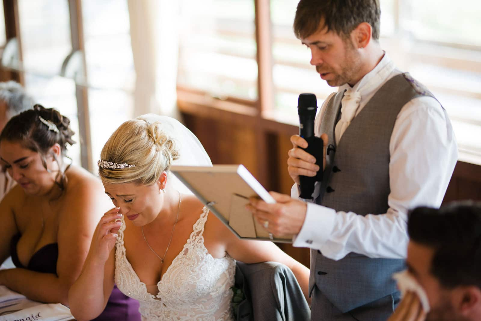 Emotional bride listening to grooms speech Wedding Photographer Oxfordshire