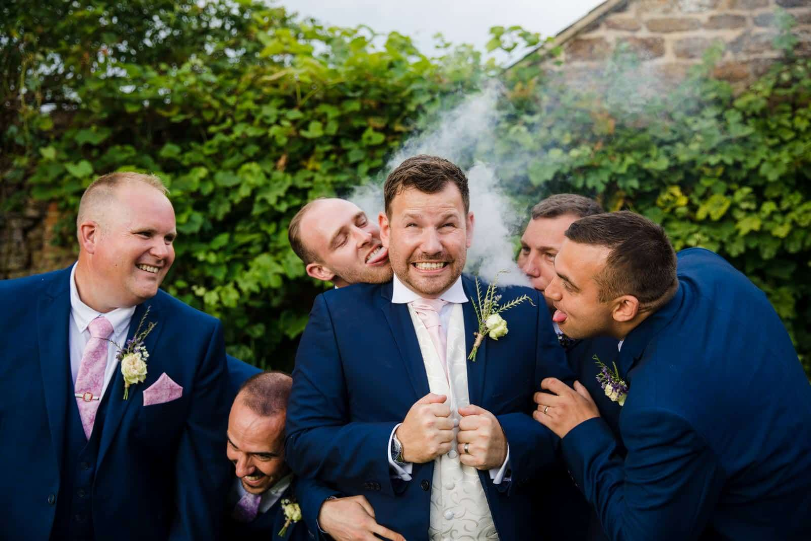 Groom feeling the heat and hot under the collar