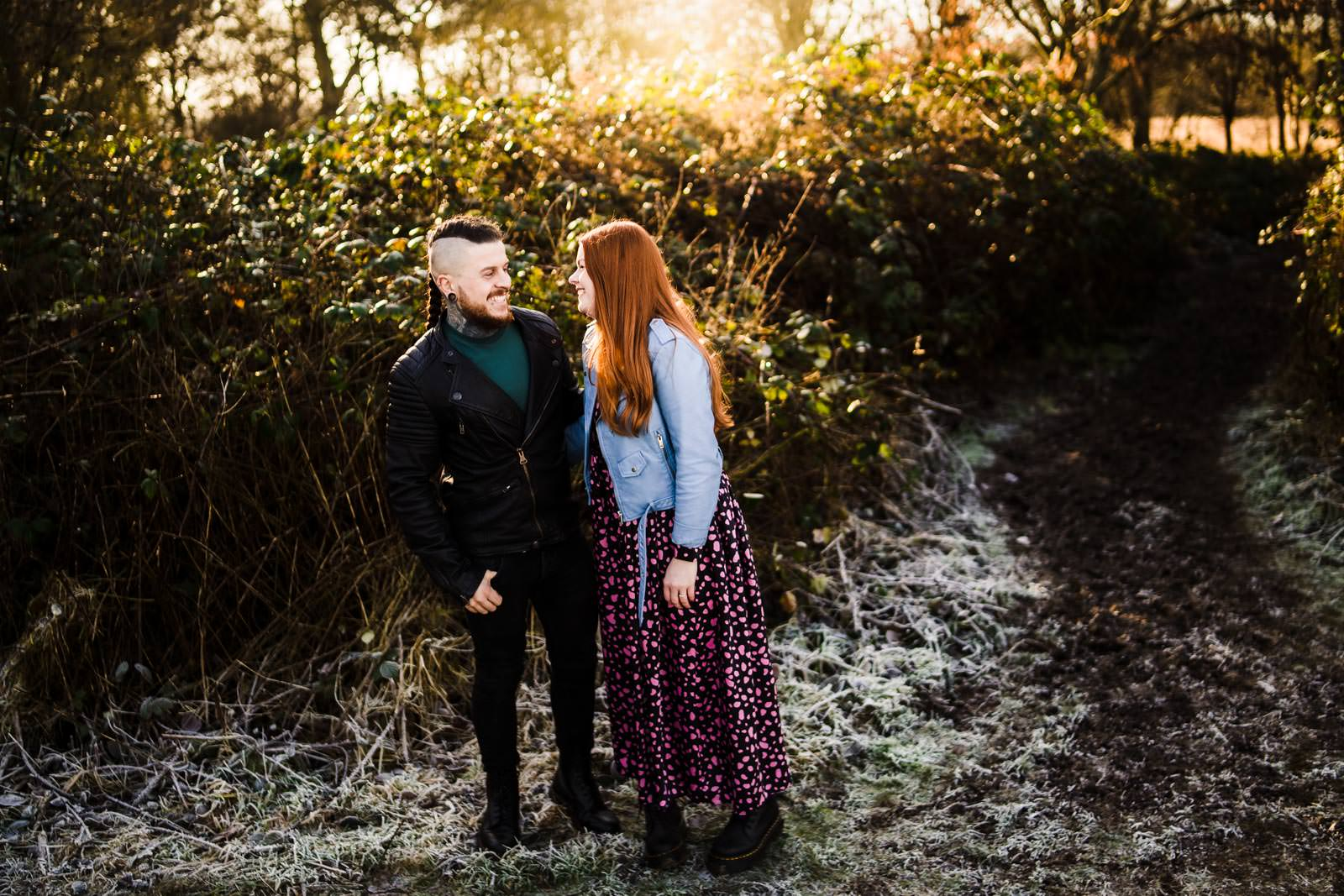 Couple at Delapre abbey for an engagement shoot, standing in frost