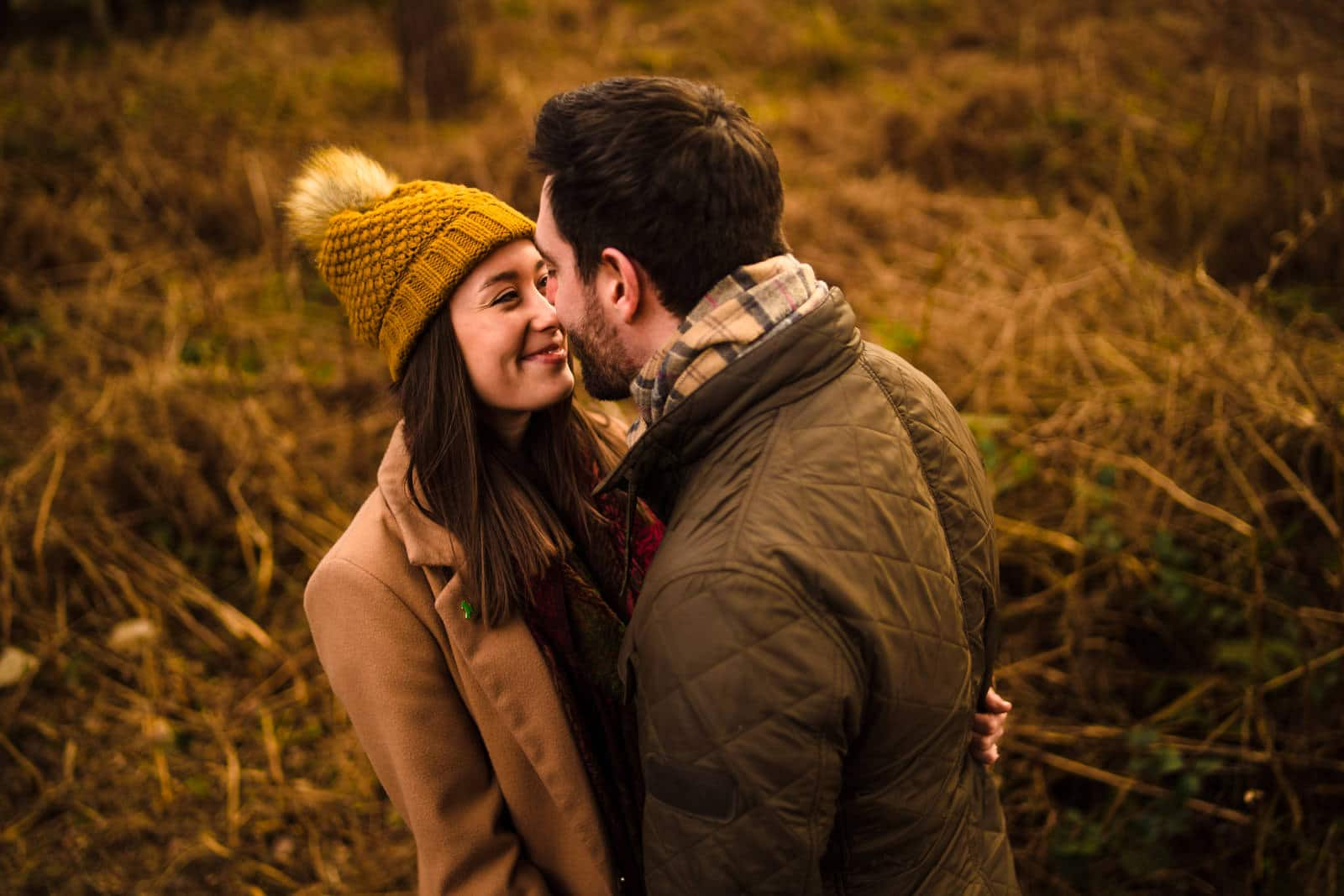 Couple rubbing noses on engagement shoot