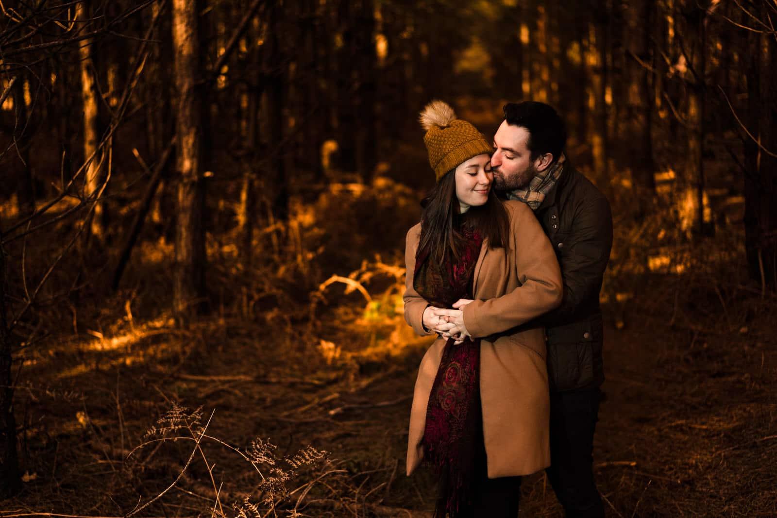 Tree walk backdrop at harlestone firs, couple embracing