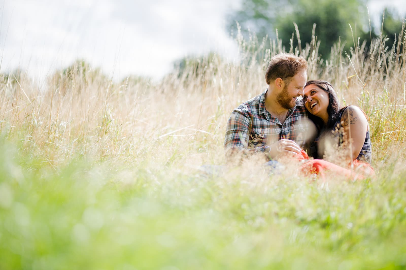 Couple sitting down in long grass
